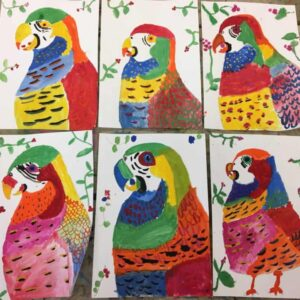 Parrots painted by children at holiday club, at Arty Amber